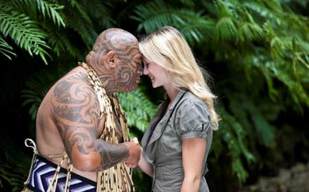TIME Unlimited Tours guide offering a hongi Maori greeting